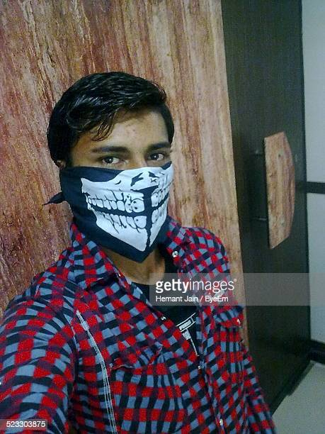 Man Covering His Face With Handkerchief