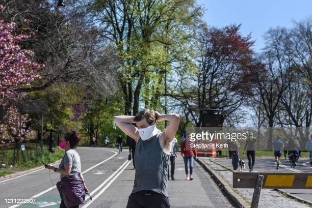 Man covers his face before jogging in Prospect Park on April 28, 2020 in the Brooklyn borough in New York City. New York City Parks Department has...