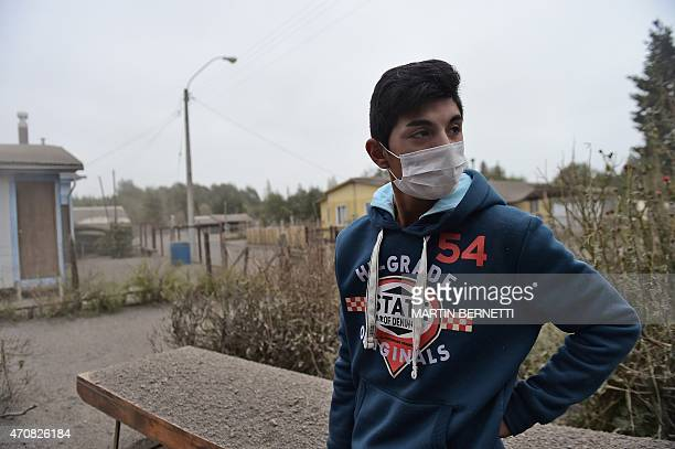 Man covers his face in La Ensenada, on April 23, 2015. Chile's Calbuco volcano erupted on Wednesday, spewing a giant funnel of ash high into the sky...