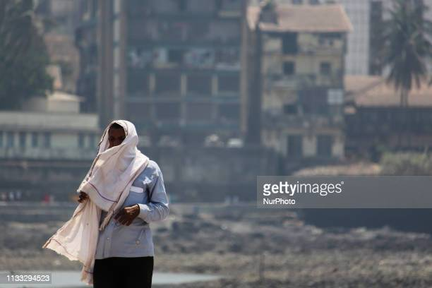 Man covers his face with a scarf to protect himself from sun on a hot day in Mumbai, India on 28 March 2019. As per the data received by India...