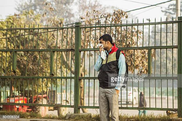 A man covers his mouth in New Delhi India on Monday Jan 11 2016 A 2judge Delhi High Court panel headed by Chief Justice G Rohini allowed the oddeven...