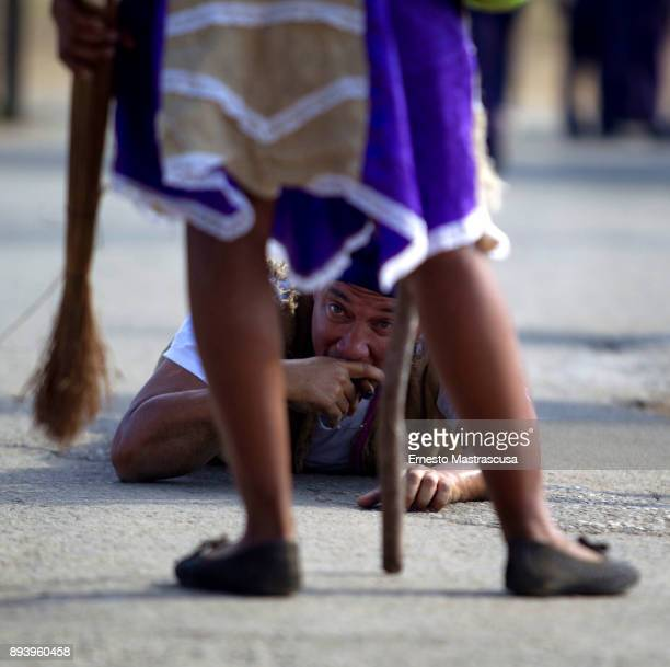 A man crawls on the street to fulfill a promise to San Lazaro on December 16 2017 in La Habana Cuba Thousands of believers gather at the Shrine of...