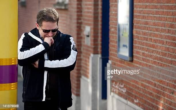 A man cries as he stands nera the entrance of the primary school SintLambertusschool in Heverlee on March 15 2012 Classmates of children killed in a...