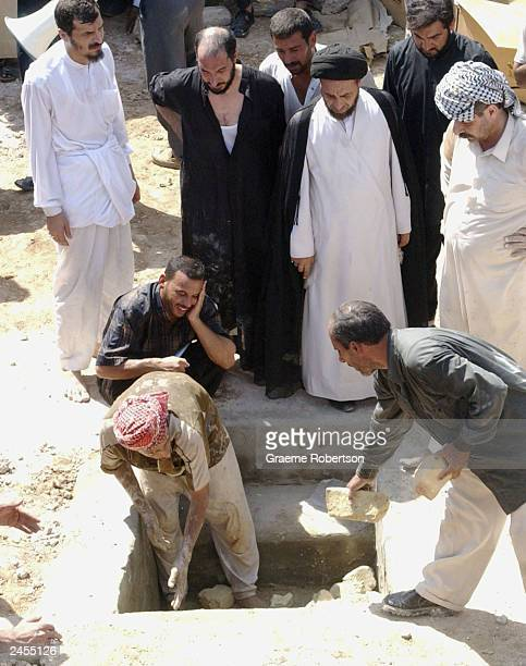 A man cries as the remains of slain Shiite Cleric Ayatollah Mohammed Baqir alHakim are buried September 2 2003 next to the 1920 Revolution Square in...