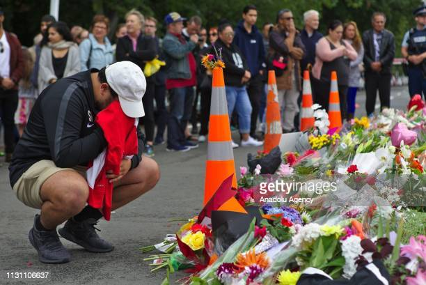 A man cries in front of the Masjid Al Noor Mosque during a public vigil close to the shooting area in Christchurch New Zealand on March 17 2019 At...