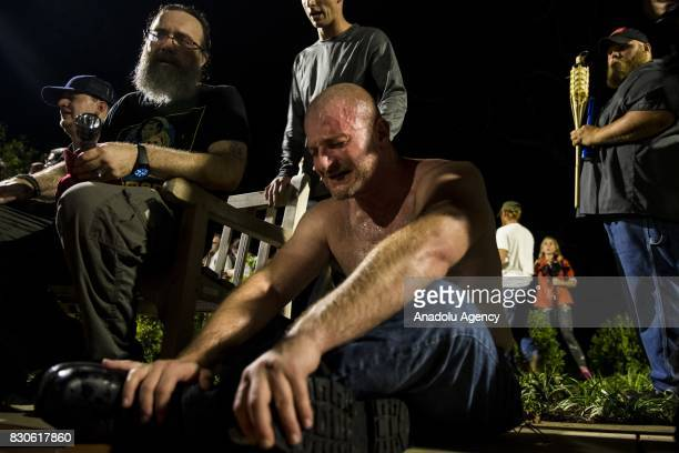 A man cringes after being hit in the face with pepper spray during a clash between counter protestors and Neo Nazis AltRight and White Supremacist...
