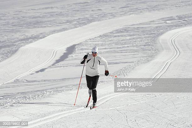 Man cross country skiing on glacier