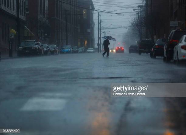 A man crosses Pearl Street in the rain on Monday April 16 2018
