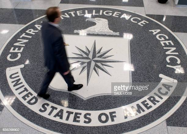 A man crosses the Central Intelligence Agency seal in the lobby of CIA Headquarters in Langley Virginia on August 14 2008 AFP PHOTO/SAUL LOEB / AFP...