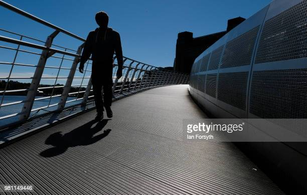 Man crosses the Millenium Bridge on the launch day of the Great Exhibition of the North on June 22, 2018 in Newcastle Upon Tyne, England. The Great...