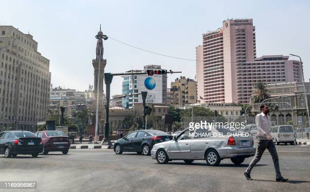 Man crosses the roundabout of the Egyptian capital Cairo's central Tahrir Square on September 21, 2019. - Protests erupted late on September 20 in...
