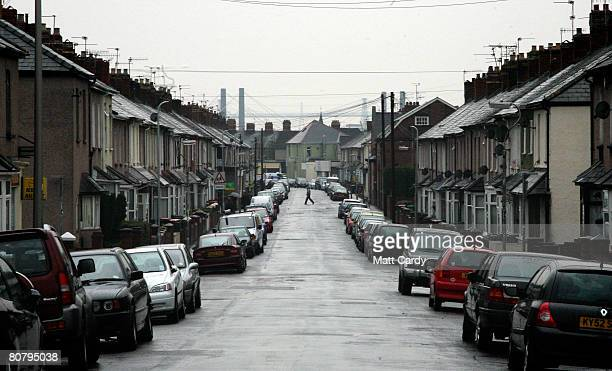 A man crosses the street on April 21 2008 in Newport Wales A poll by researchers Fitch has revealed 10 subprime blackspots across the UK areas where...