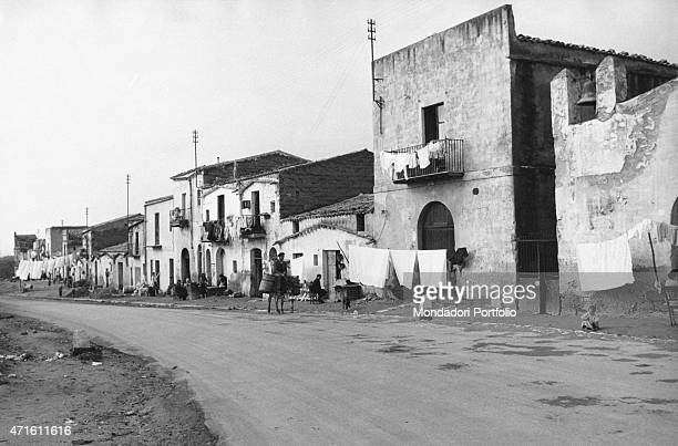 'A man crossing a road by riding a donkey Agrigento December 1956 '