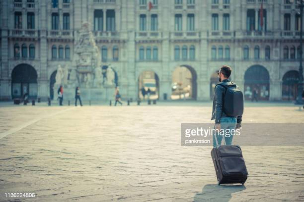 man crossing the city square - europe stock pictures, royalty-free photos & images