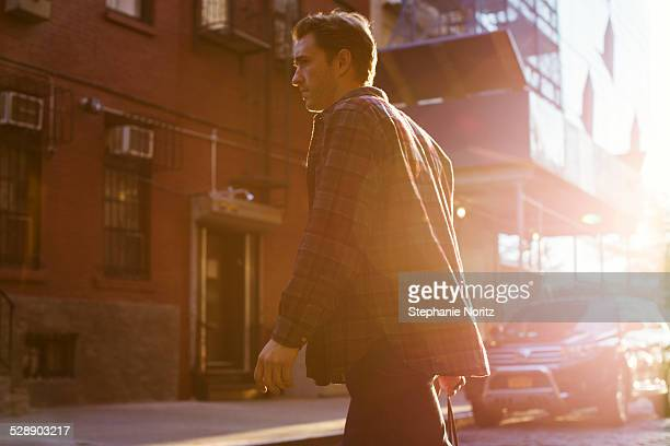 man crossing the street in urban setting - cool cars stock pictures, royalty-free photos & images