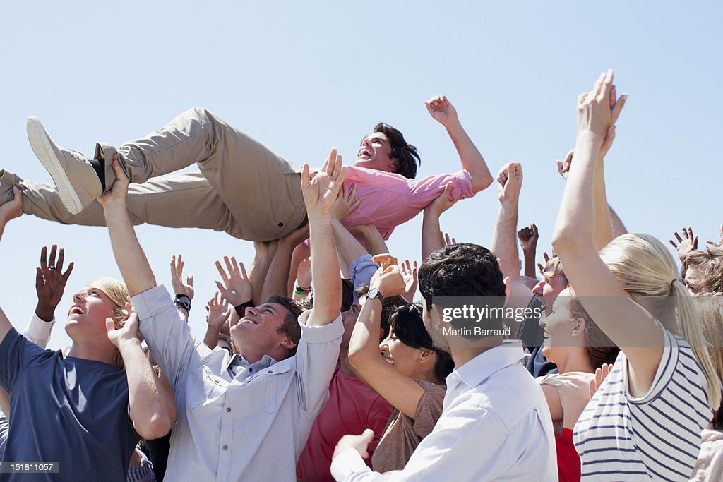 Man crowd surfing : Stock Photo