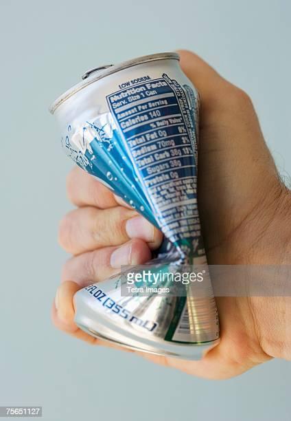 Man crushing tin can