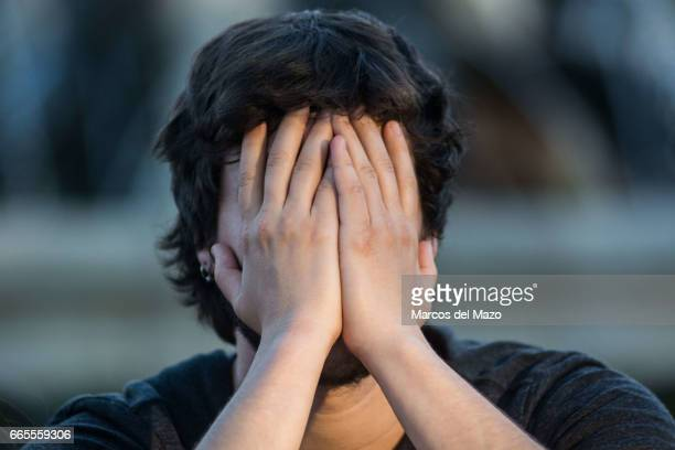 A man crying during an event organized through Facebook under the name 'Gathering for crying' celebrated in the Retiro Park