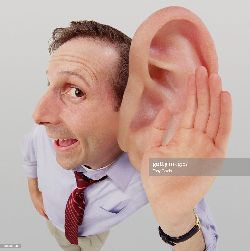 Man Cupping Hand Over Big Ear Stock Photo | Getty Images