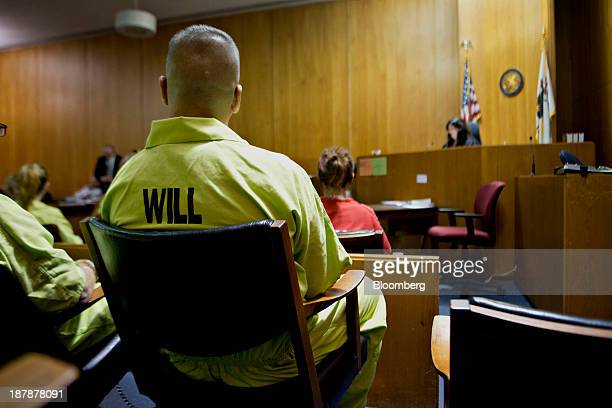 A man currently incarcerated in the Will County Jail sits in the jury box during a session of drug court in the courtroom of Carla...