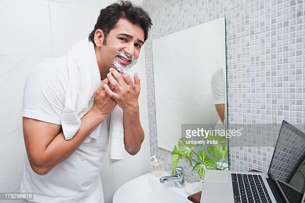 Man cut himself while shaving in the bathroom