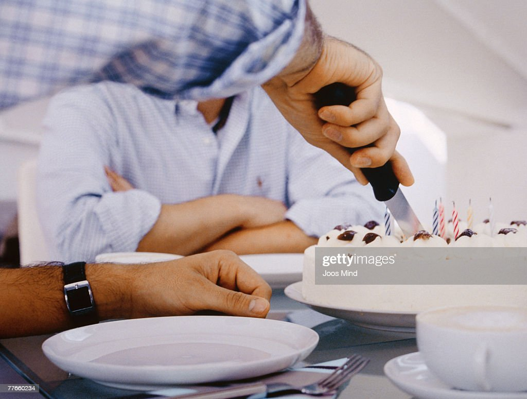 Man Cutting Birthday Cake Stock Photo Getty Images