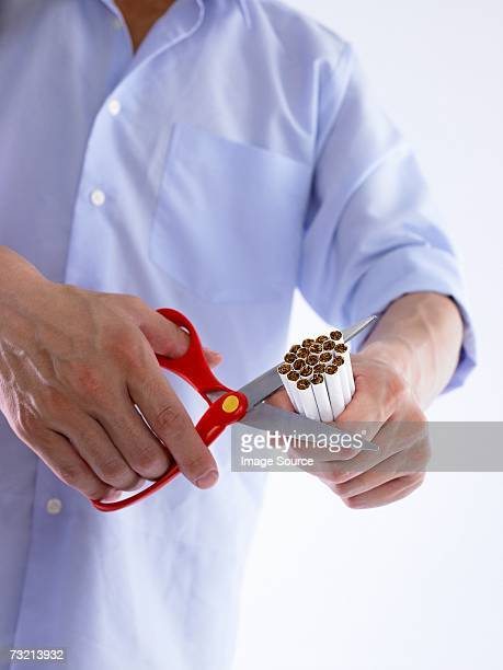 Man cutting cigarettes