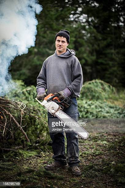 A man cutting fire wood.