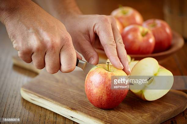 man cutting gala apples for a snack - cutting stock pictures, royalty-free photos & images