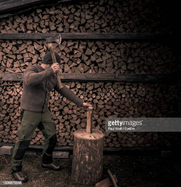 man cutting logs - firewood stock pictures, royalty-free photos & images