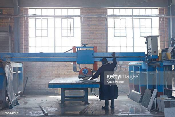 Man cutting marble at factory