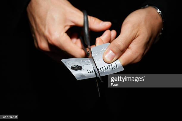 Man Cutting Platinum Credit Card
