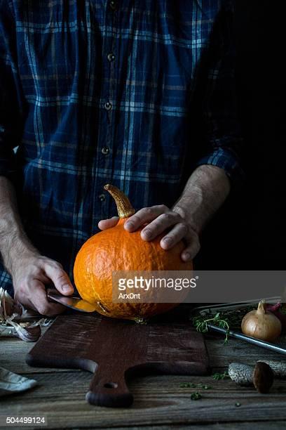 Man cutting pumpkin