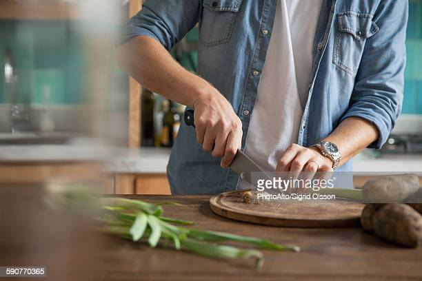 Man cutting spring onion