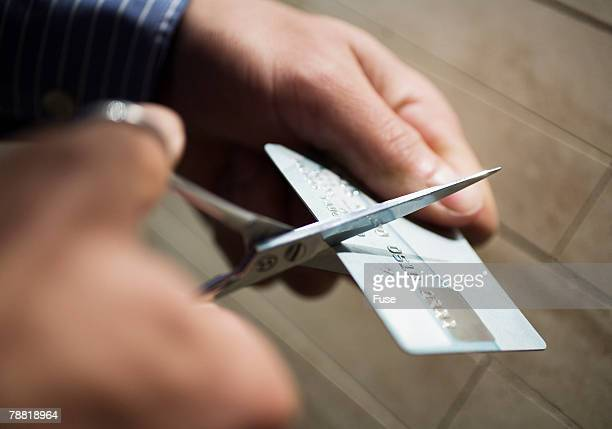 Man Cutting Up Credit Card