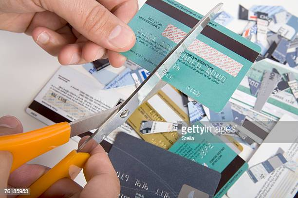 A man cutting up credit cards