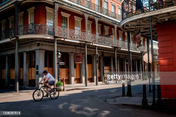 """Man cycles along Jackson Square in New Orleans, Louisiana, on March 26, 2020. - New Orleans, the Louisiana city known as the """"Big Easy"""" famed for its..."""