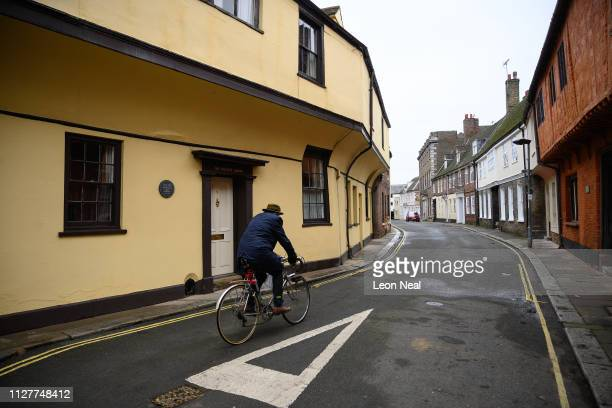 A man cycles down a road of medieval buildings on February 05 2019 in King's Lynn England The seaport town of Lynn grew rapidly through the 1100s and...