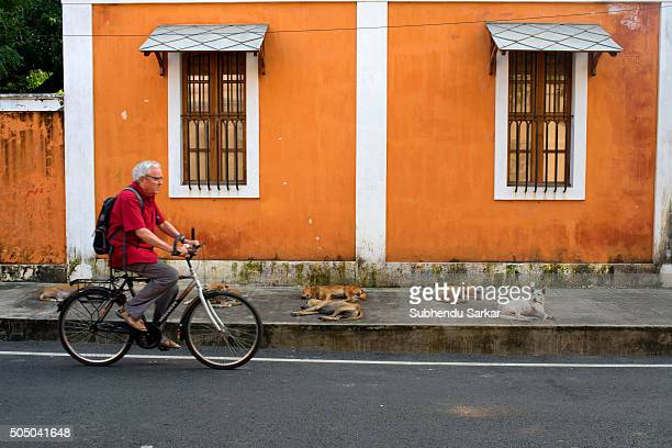 A man cycles on a road in Puducherry Puducherry formerly known as Pondicherry is a Union Territory of India In 1674 Pondicherry became a French...