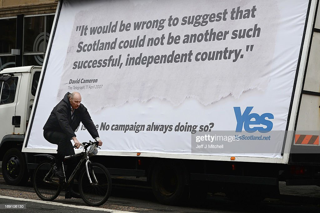 A man cycles past a billboard ahead of the UK government's launch of the Scotland Analysis Financial Services and Banking Paper on May 20, 2013 in Edinburgh, Scotland. The paper claimed that savers and pensioners would be at risk in an independent Scotland.