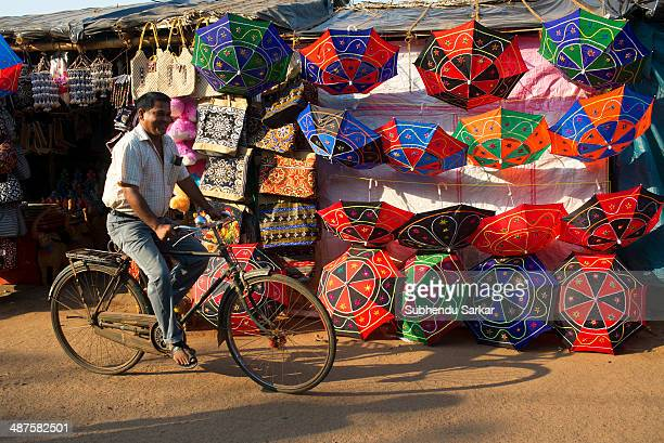 A man cycles past a roadside shop dealing in various handicraft products in Puri Puri a city in Odisha in India is situated on the Bay of Bengal It...