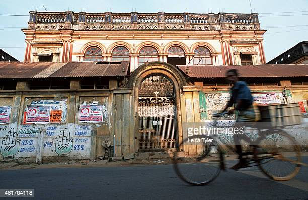 A man cycles past the shattered remains of an old mansion in Chettinad Tamil Nadu Once home to the Chettiars some of India's wealthiest merchants...