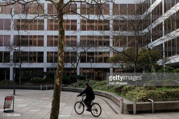 A man cycles through a square in the town centre on February 20 2019 in Swindon England The car manufacturer Honda announced on Tuesday it is to shut...