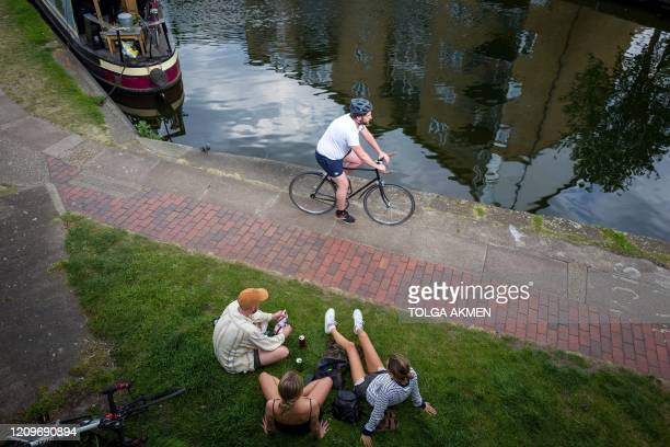 A man cycles to take their daily exercise on the towpath of the Hertford Union Canal in east London on April 11 2020 as warm weather tests the...