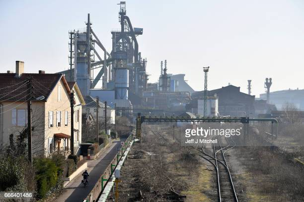 A man cycles toward the ArcelorMittal steel works on February 14 2017 in HayangeFrance The people of the French Rust Belt are expected to play a key...