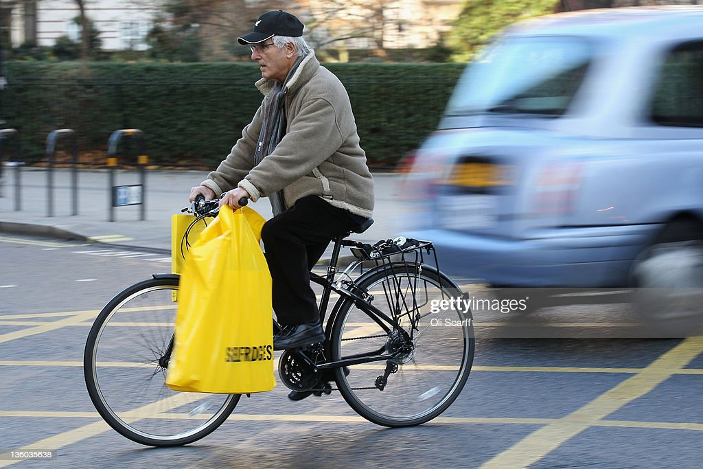 A man cycles with shopping bags on his bike on the penultimate Saturday before Christmas Day on December 17, 2011 in London, England. Retail analysts have predicted that today will be the busiest day of the year for high street gift purchases with spending set to exceed 1 billion GBP.