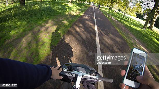 a man cycling and listening to music - jcbonassin stock pictures, royalty-free photos & images
