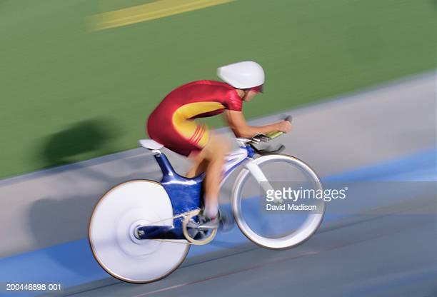 Man cycling in velodrome (blurred motion)