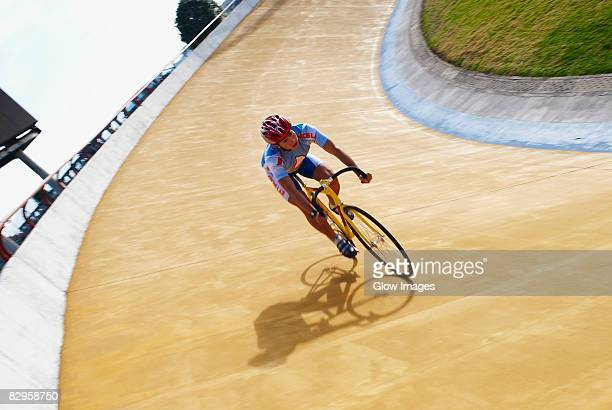 man cycling on a sports track - track cycling stock pictures, royalty-free photos & images