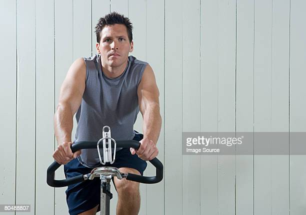A man cycling on an exercise bike